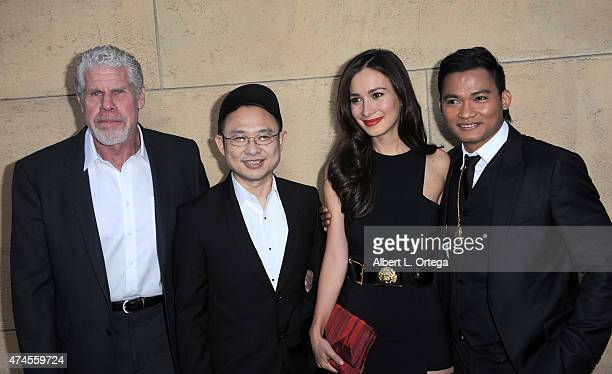 Actor Ron Perlman director Ekachai Uekrongtham actress Celina Jade and actor Tony Jaa arrive for the premiere Of 'Skin Trade' held at the Egyptian...