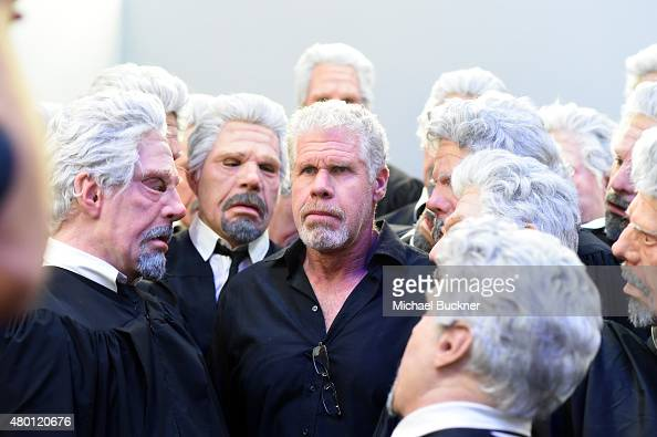 """Actor Ron Perlman of """"Hand of God"""" poses with Ron Perlman impersonators at The Getty Images Portrait Studio powered by Samsung Galaxy At ComicCon..."""