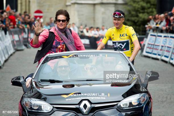US actor Ronn Moss and British cyclist Chris Froome ride in a car before the start of the 82nd edition of the 'Natourcriterium Aalst' cycling race in...
