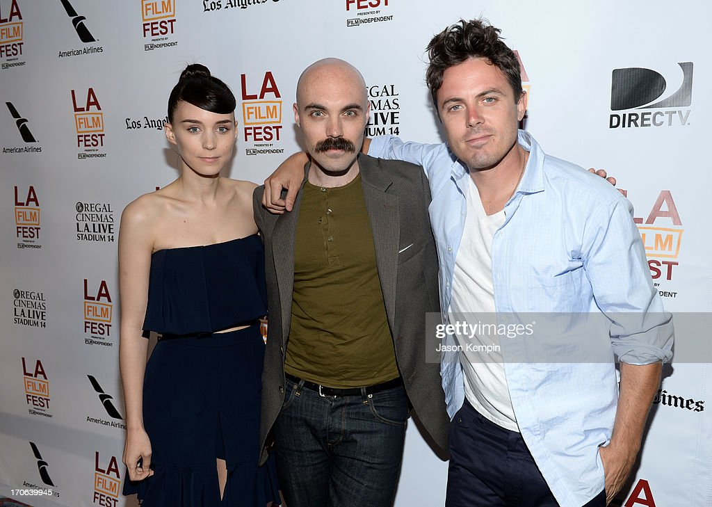 Actor <a gi-track='captionPersonalityLinkClicked' href=/galleries/search?phrase=Rooney+Mara&family=editorial&specificpeople=5669181 ng-click='$event.stopPropagation()'>Rooney Mara</a>, writer/director David Lowery and actor <a gi-track='captionPersonalityLinkClicked' href=/galleries/search?phrase=Casey+Affleck&family=editorial&specificpeople=1539212 ng-click='$event.stopPropagation()'>Casey Affleck</a> arrive at the 'Ain't Them Bodies Saints' premiere during the 2013 Los Angeles Film Festival at Regal Cinemas L.A. Live on June 15, 2013 in Los Angeles, California.