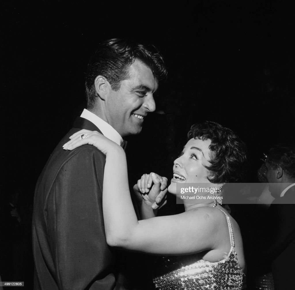 Actor Rory Calhoun dances with actress Lita Baron during a premiere party for 'Trapeze' in Los Angeles California
