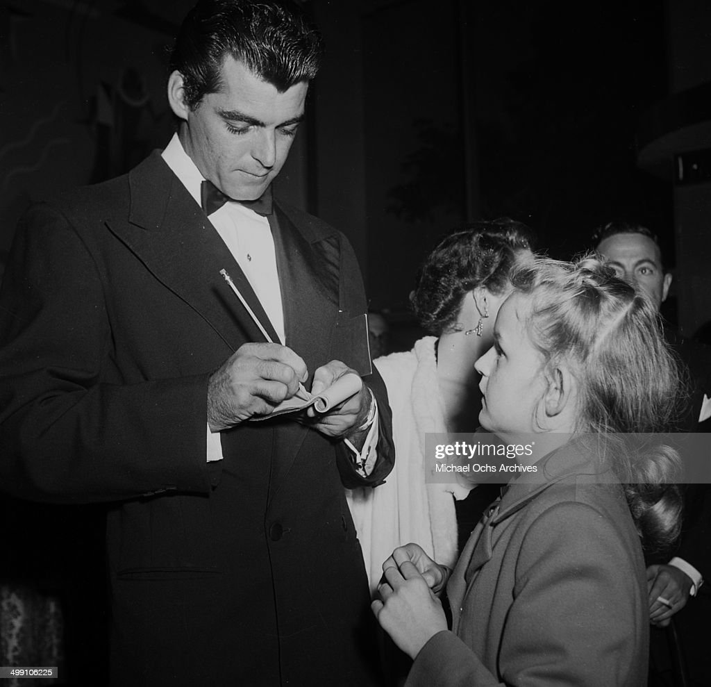 Actor Rory Calhoun signs autograph for a young fan in Los Angeles California