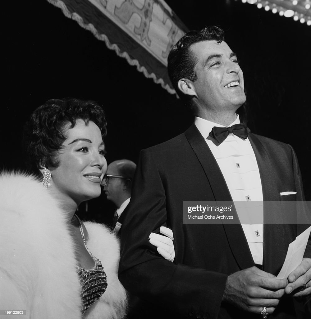 Actor Rory Calhoun with actress Lita Baron attends a premiere party for 'Trapeze' in Los Angeles California