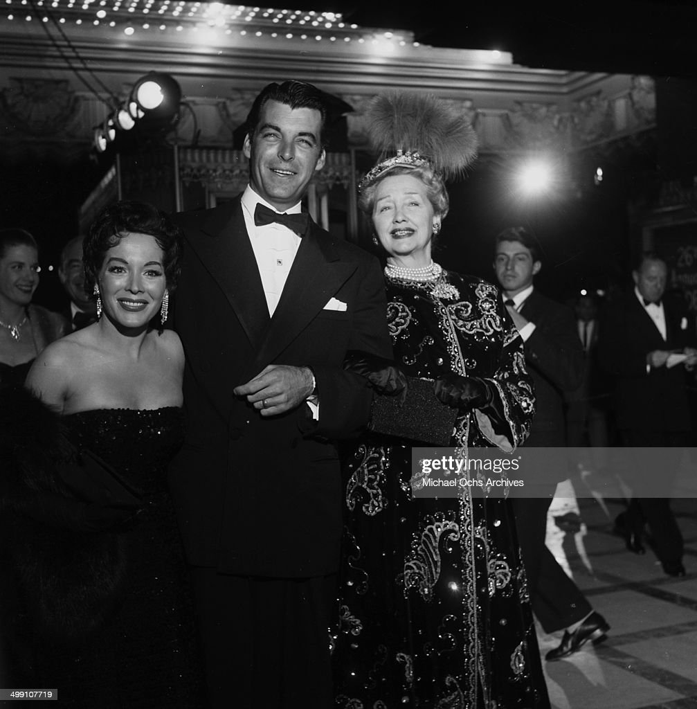 Actor Rory Calhoun with actress Lita Baron attends a premiere with gossip columnists Hedda Hopper in Los Angeles California