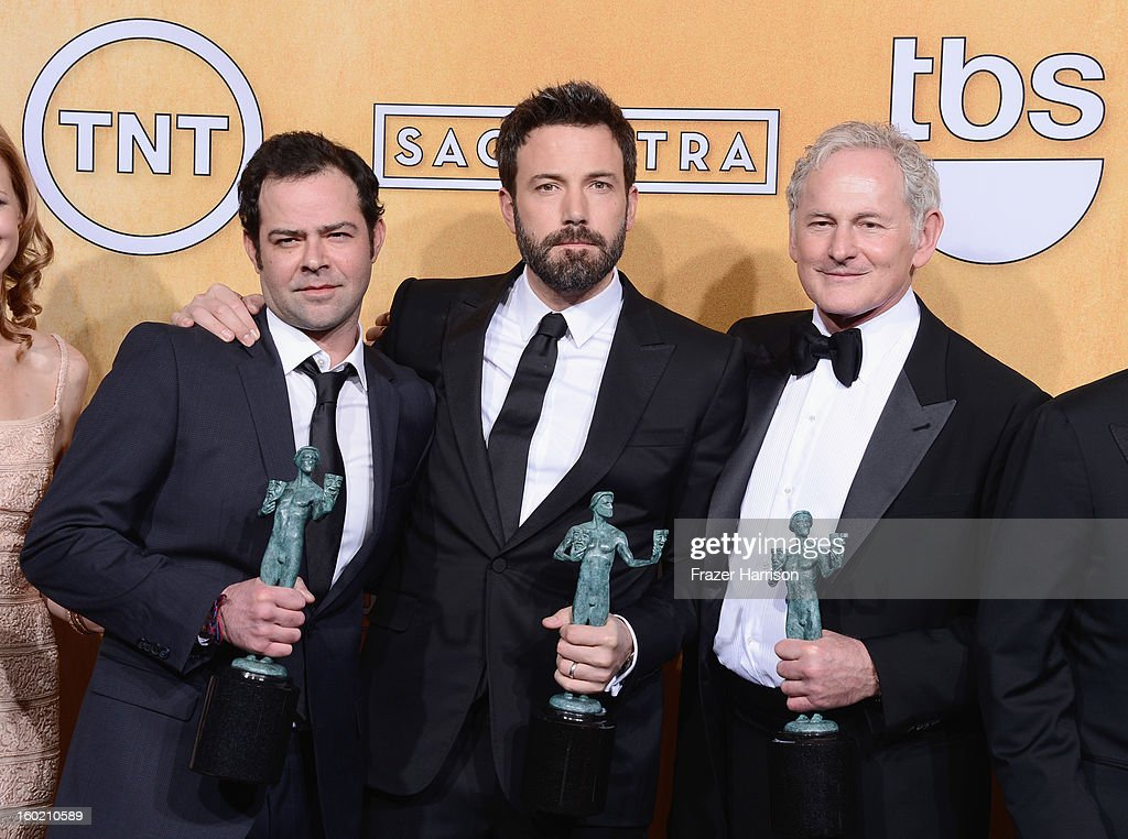 Actor Rory Cochrane, actor-director Ben Affleck and actor Victor Garber, winners of Outstanding Performance by a Cast in a Motion Picture for 'Argo,' pose in the press room during the 19th Annual Screen Actors Guild Awards held at The Shrine Auditorium on January 27, 2013 in Los Angeles, California.