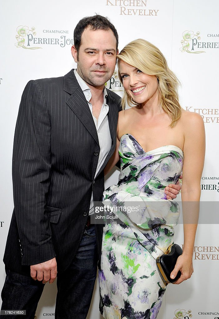 Actor Rory Cochrane (L) and Ali Larter celebrate the release of Ali Larter's new cookbook 'Kitchen Revelry' with Perrier-Jouet at Sunset Tower on August 27, 2013 in West Hollywood, California.