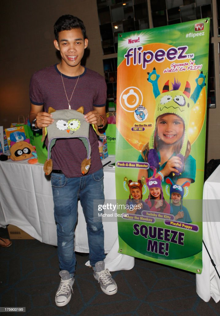 Actor Roshon Fegan poses with Flipeez At KIIS FM PreTeen Choice Awards Gifting Suite on August 9 2013 in Los Angeles California