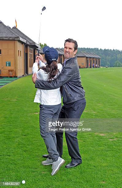 Actor Rupert Everett and Mariella Ahrens attend the 'BMW Golf Cup 2012' on June 16 2012 in Michendorf Germany