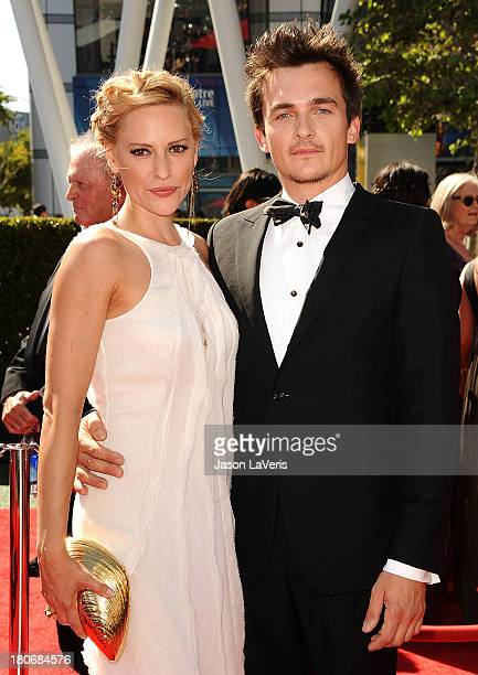 Actor Rupert Friend and Aimee Mullins attend the 2013 Creative Arts Emmy Awards at Nokia Theatre LA Live on September 15 2013 in Los Angeles...