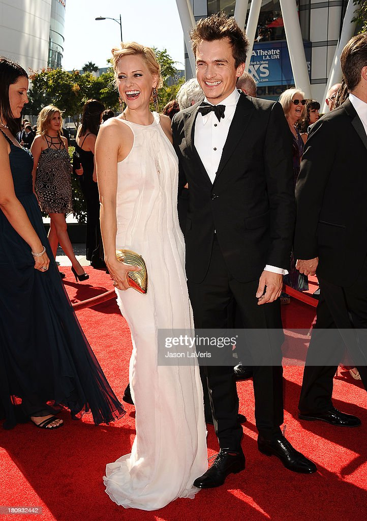 Actor Rupert Friend (R) and Aimee Mullins attend the 2013 Creative Arts Emmy Awards at Nokia Theatre L.A. Live on September 15, 2013 in Los Angeles, California.