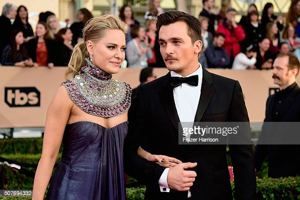 Actor Rupert Friend and Aimee Mullins attend the 22nd Annual Screen Actors Guild Awards at The Shrine Auditorium on January 30 2016 in Los Angeles...