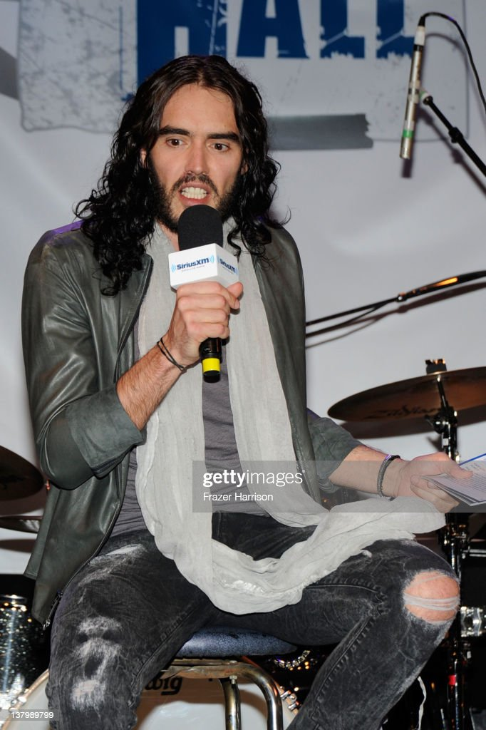 Actor <a gi-track='captionPersonalityLinkClicked' href=/galleries/search?phrase=Russell+Brand&family=editorial&specificpeople=536593 ng-click='$event.stopPropagation()'>Russell Brand</a> on stage at the 'SiriusXM's Town Hall With Ringo Starr' And Host <a gi-track='captionPersonalityLinkClicked' href=/galleries/search?phrase=Russell+Brand&family=editorial&specificpeople=536593 ng-click='$event.stopPropagation()'>Russell Brand</a> And Moderator Don Was Live On SiriusXM's The Spectrum Channel performs at Troubadour on January 30, 2012 in West Hollywood, California.