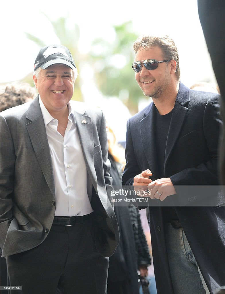 Actor Russell Crowe and TV host Jay Leno arrive while Russell Crowe is honored on the Hollywood Walk Of Fame on April 12 2010 in Hollywood California