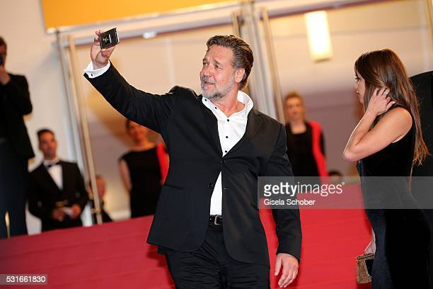 Actor Russell Crowe photographs during 'The Nice Guys' premiere during the 69th annual Cannes Film Festival at the Palais des Festivals on May 15...