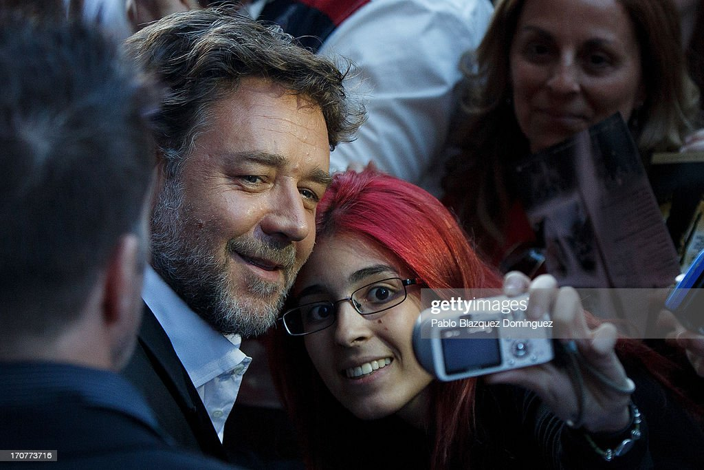 Actor <a gi-track='captionPersonalityLinkClicked' href=/galleries/search?phrase=Russell+Crowe&family=editorial&specificpeople=202609 ng-click='$event.stopPropagation()'>Russell Crowe</a> stands with fans during the 'Man of Steel' (El Hombre de Acero) premiere at the Capitol cinema on June 17, 2013 in Madrid, Spain.