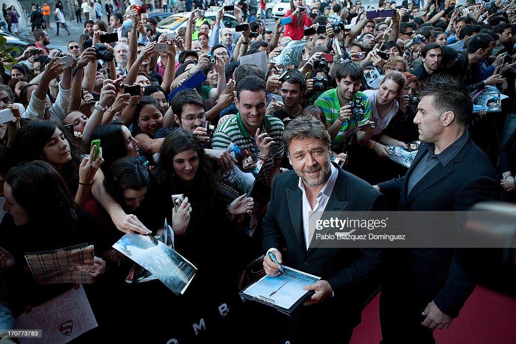 Actor Russell Crowe stands with fans during the 'Man of Steel' (El Hombre de Acero) premiere at the Capitol cinema on June 17, 2013 in Madrid, Spain.