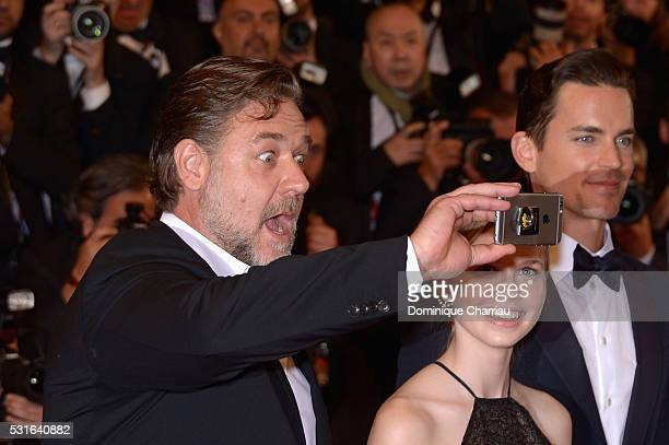 Actor Russell Crowe takes a selfie with actress Angourie Rice and actor Matt Bomer at 'The Nice Guys' premiere during the 69th annual Cannes Film...