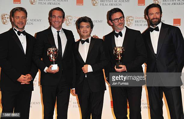 Actor Russell CroweJean Dujardin producer Thomas Langmann and director Michel Hazanavicius and actor Hugh Jackman pose in the press room with the...