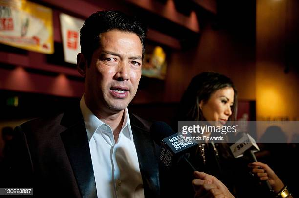 Actor Russell Wong and producer Wendi Deng Murdoch arrive at the Bluray DVD Release Of Twentieth Century Fox Home Entertainment's 'Snow Flower And...