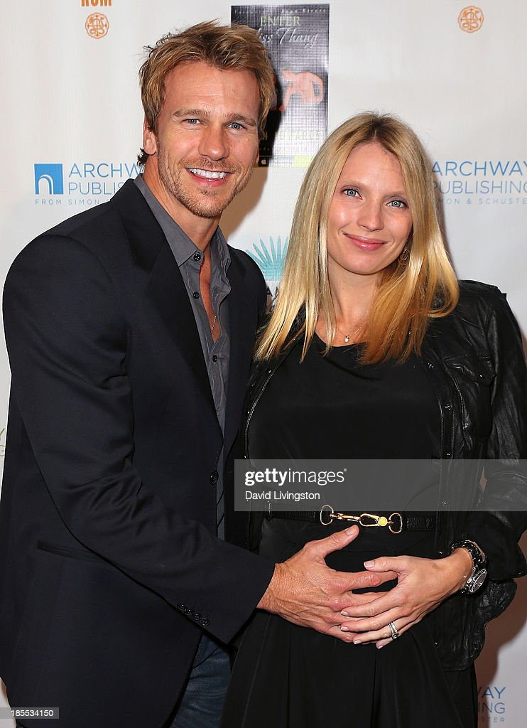 Actor Rusty Joiner (L) and wife Charity Walden attend the launch party for Brian Edwards' book 'Enter Miss Thang' at Cafe Habana on October 21, 2013 in Malibu, California.