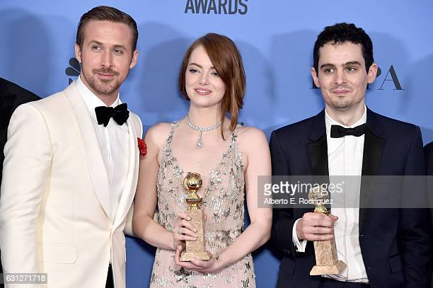 Actor Ryan Gosling actress Emma Stone and filmmaker Damien Chazelle pose in the press room during the 74th Annual Golden Globe Awards at The Beverly...