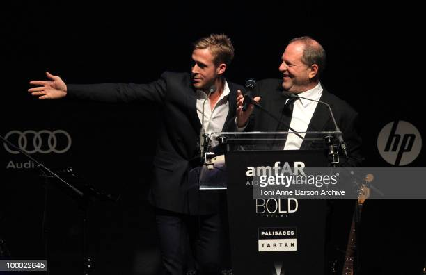 Actor Ryan Gosling and producer Harvey Weinstein speak during amfAR's Cinema Against AIDS 2010 benefit gala at the Hotel du Cap on May 20 2010 in...