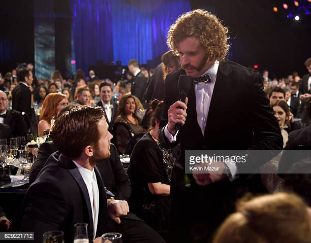 Actor Ryan Gosling and TJ Miller attend The 22nd Annual Critics' Choice Awards at Barker Hangar on December 11 2016 in Santa Monica California