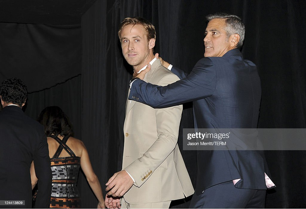 Actor <a gi-track='captionPersonalityLinkClicked' href=/galleries/search?phrase=Ryan+Gosling&family=editorial&specificpeople=214557 ng-click='$event.stopPropagation()'>Ryan Gosling</a> (L) and writer/director/actor <a gi-track='captionPersonalityLinkClicked' href=/galleries/search?phrase=George+Clooney&family=editorial&specificpeople=202529 ng-click='$event.stopPropagation()'>George Clooney</a> arrive at 'Ides Of March' Premiere at Roy Thomson Hall during the 2011 Toronto International Film Festival on September 9, 2011 in Toronto, Canada.