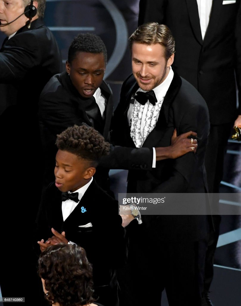 Actor Ryan Gosling (R) congratulates actors Ashton Sanders (L) and Jaden Piner (C) after 'Moonlight' wins Best Picture onstage during the 89th Annual Academy Awards at Hollywood & Highland Center on February 26, 2017 in Hollywood, California.