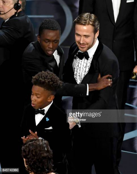 Actor Ryan Gosling congratulates actors Ashton Sanders and Jaden Piner after 'Moonlight' wins Best Picture onstage during the 89th Annual Academy...
