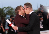 Actor Ryan Gosling kisses Director Nicolas Winding Refn after he wins Award for Best Director for his film 'Drive' during the Palme D'Or Winners...