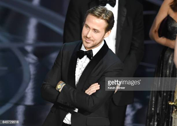 Actor Ryan Gosling listens as a presentation error which resulted in Best Picture being announced as 'La La Land' instead of 'Moonlight' is announced...