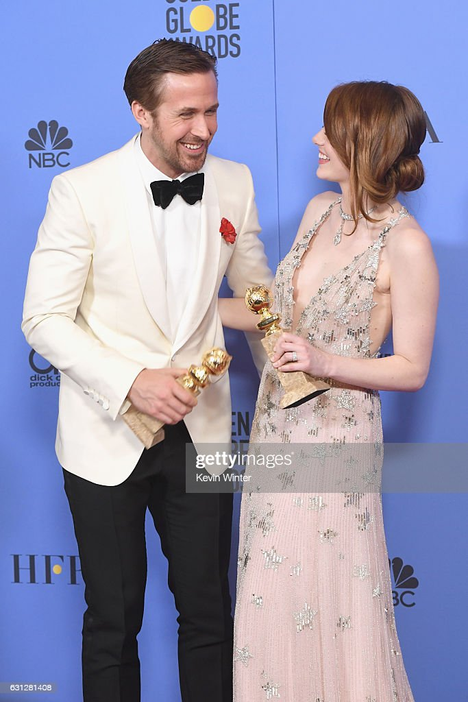 Actor Ryan Gosling (L), winner of Best Actor in a Motion Picture - Musical or Comedy for 'La La Land,' and actress Emma Stone, winner of Best Actress in a Motion Picture - Musical or Comedy for 'La La Land,' pose in the press room during the 74th Annual Golden Globe Awards at The Beverly Hilton Hotel on January 8, 2017 in Beverly Hills, California.