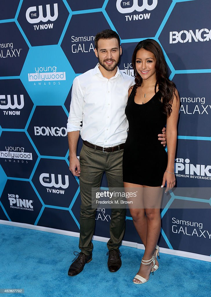 Actor Ryan Guzman (L) and tv personality Melanie Iglesias attend the 2014 Young Hollywood Awards held at The Wiltern on July 27, 2014 in Los Angeles, California.