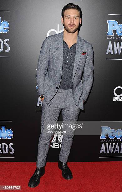 Actor Ryan Guzman arrives at The PEOPLE Magazine Awards at The Beverly Hilton Hotel on December 18 2014 in Beverly Hills California