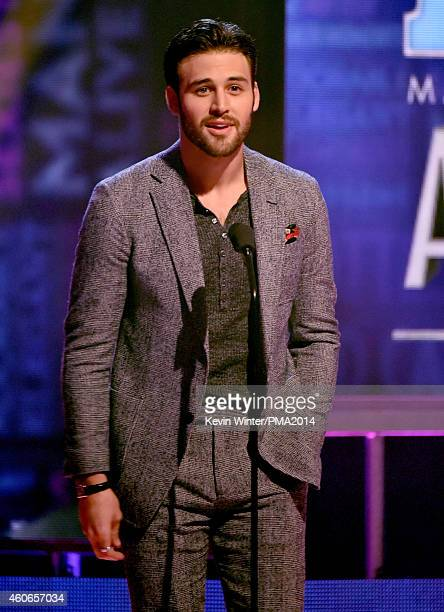 Actor Ryan Guzman speaks onstage during the PEOPLE Magazine Awards at The Beverly Hilton Hotel on December 18 2014 in Beverly Hills California