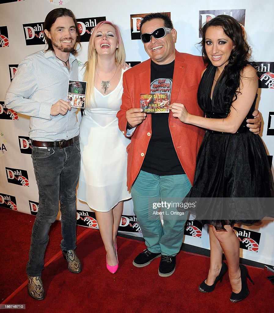 Actor Ryan Kiser, actress Jessica Cameron, director L.J. Rivera III, actress Devanny Pinn arrive for 'The Black Dahlia Haunting' DVD Release Party held at The Station Hollywood on October 15, 2013 in Hollywood, California.