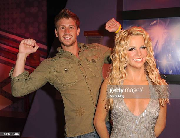Actor Ryan McIntyre with Britney Spears figure at the Official Los Angeles Event Celebrating Harvey Milk Day at Madame Tussaud's Hollywood on May 22...
