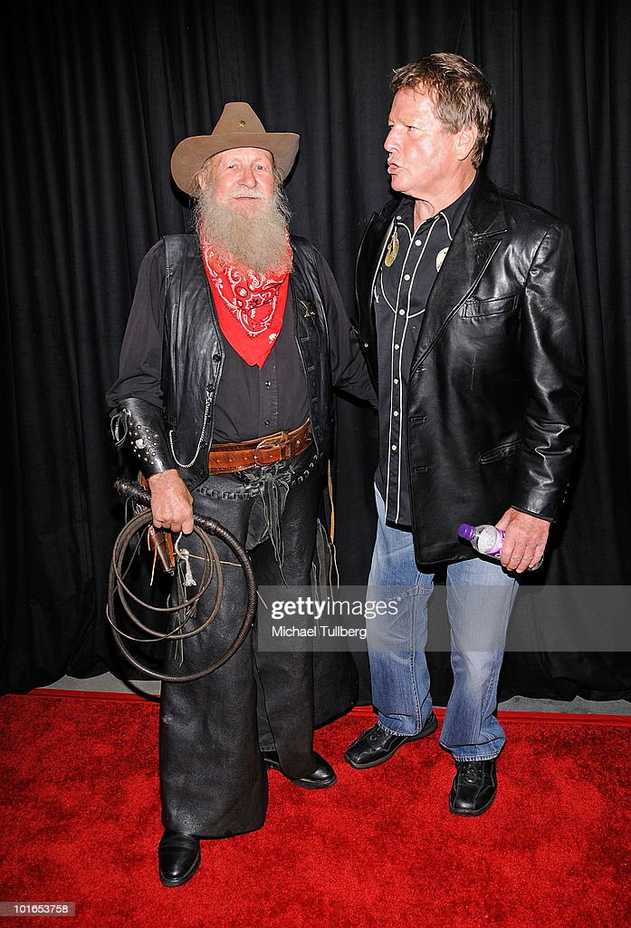 Actor Ryan O'Neal (R) arrives at SHARE's 57th Annual BOOMTOWN Event to help at-risk youth held at the Santa Monica Civic Auditorium on June 5, 2010 in Santa Monica, California.