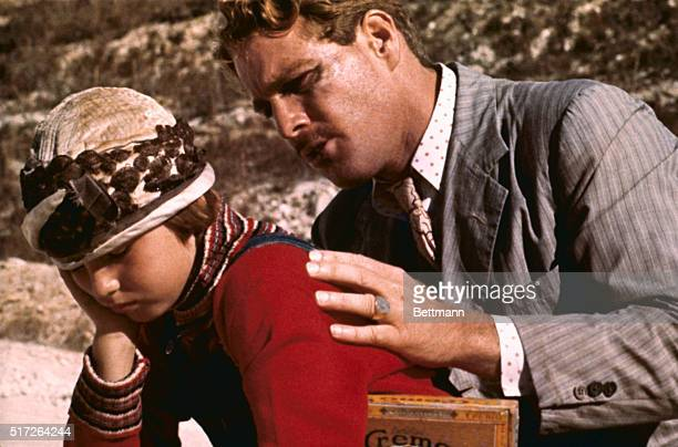 Actor Ryan O'Neal speaks to his daughter Tatum in a scene from the movie Paper Moon