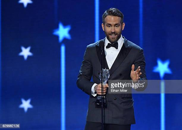 Actor Ryan Reynolds accepts the award for Best Actor in a Comedy Movie for 'Deadpool' during the 22nd Annual Critics' Choice Awards at Barker Hangar...