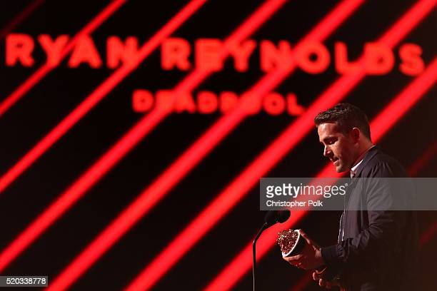 Actor Ryan Reynolds accepts the award for Best Male Performance for 'Deadpool' onstage during the 2016 MTV Movie Awards at Warner Bros Studios on...