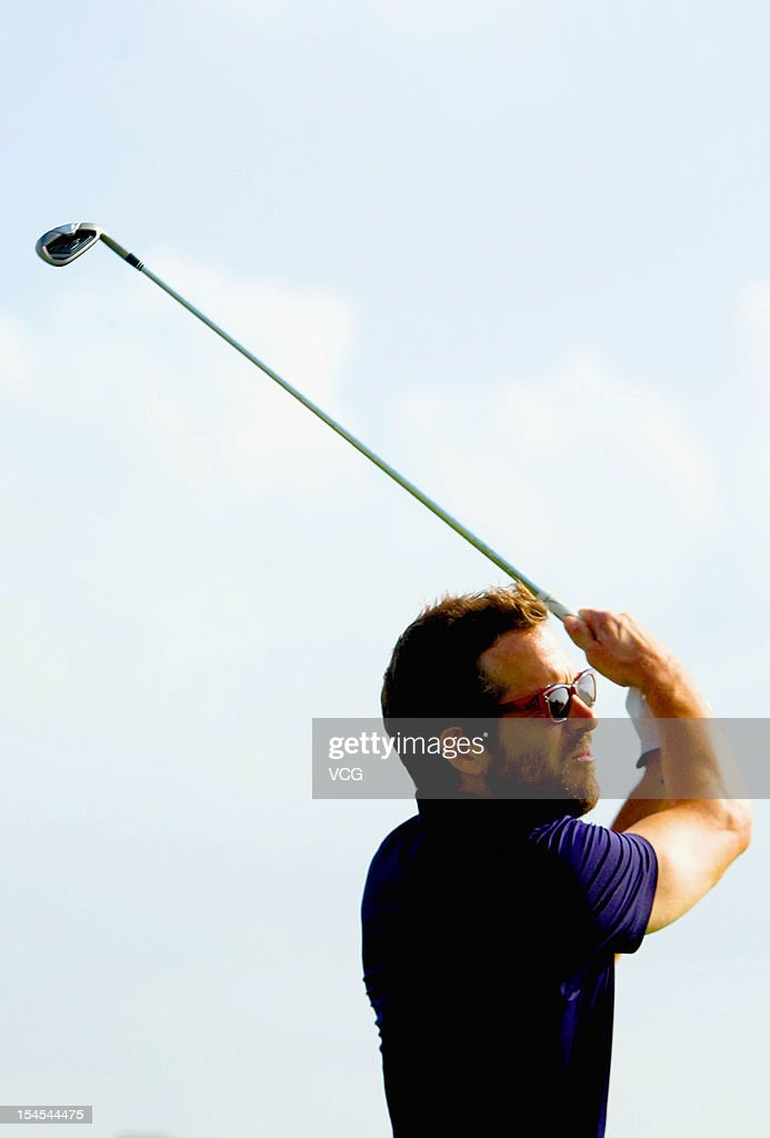 Actor Ryan Reynolds in action during day four of the Mission Hills Star Trophy at the Mission Hills Golf Club on October 21, 2012 in Haikou, China.