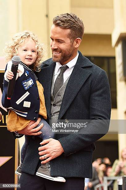Actor Ryan Reynolds poses for a photo with his daughter James Reynolds during a ceremony honoring him with a star on the Hollywood Walk of Fame on...