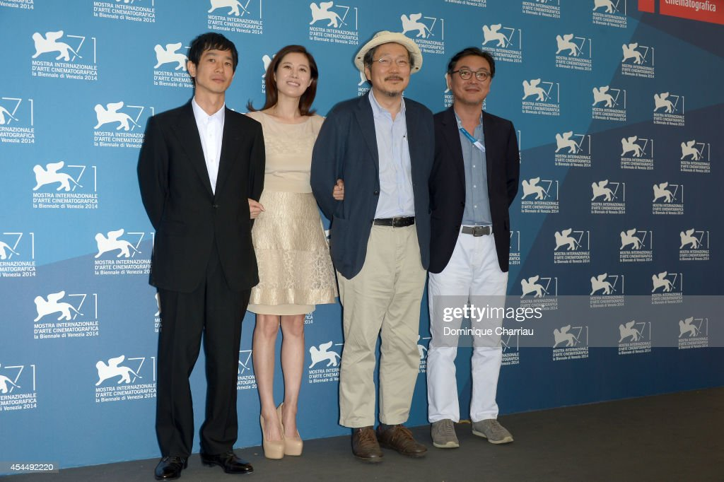 Actor <a gi-track='captionPersonalityLinkClicked' href=/galleries/search?phrase=Ryo+Kase&family=editorial&specificpeople=665905 ng-click='$event.stopPropagation()'>Ryo Kase</a>, actress Moon Sori, director Hong Sangsoo and actor Kim Euisung attend the 'Hill Of Freedom' (Jayueui Onduk)photocall during the 71st Venice Film Festival on September 2, 2014 in Venice, Italy.