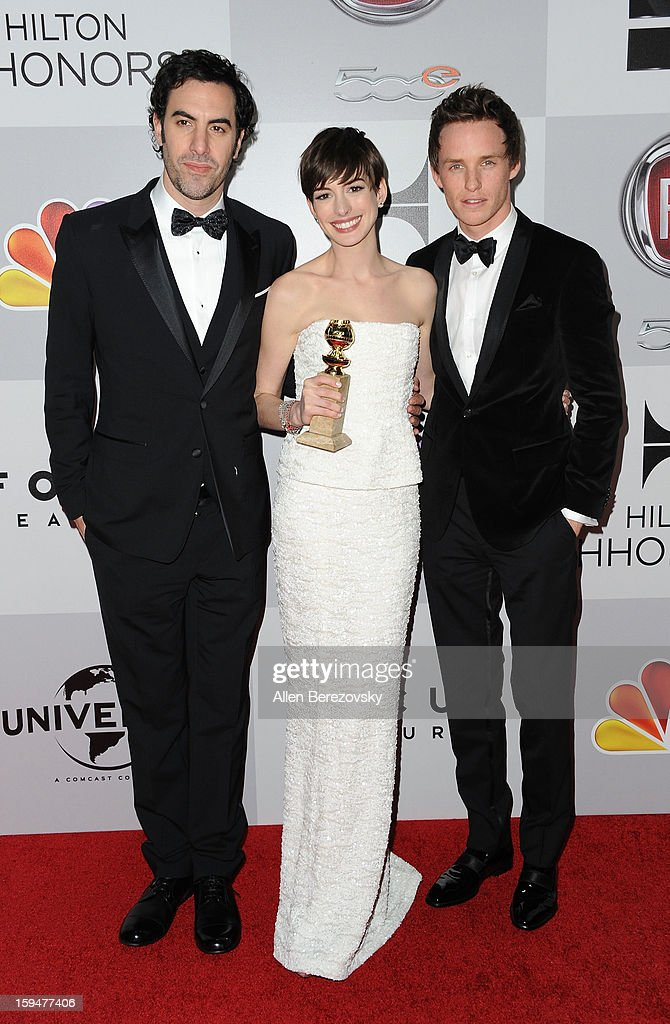 Actor Sacha Baron Cohen, actress Anne Hathaway, and actor Eddie Redmayne of 'Les Miserables' arrive at the NBC Universal's 70th annual Golden Globe Awards after party on January 13, 2013 in Beverly Hills, California.