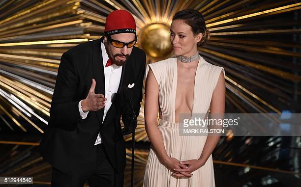Actor Sacha Baron Cohen and Olivia Wilde speak on stage at the 88th Oscars on February 28 2016 in Hollywood California AFP PHOTO / MARK RALSTON / AFP...