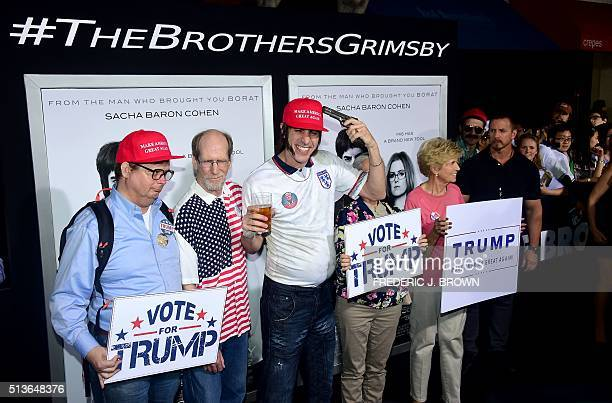 Actor Sacha Baron Cohen poses with supporters of Republican Presidential candidate Donald Trump before for the premiere of the film 'The Brothers...