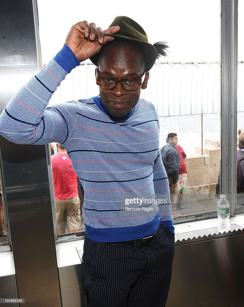 Actor Sahr Ngaujah poses as Tony Award nominees visits The Empire State Building on June 9, 2010 in New York City.