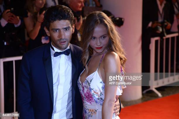 Actor Salim Kechiouche and actress Lou Luttiau attend the premiere of the movie 'Mektoub My Love Canto Uno' presented in competition at the 74th...